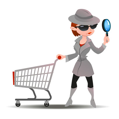 Mystery shopper woman in spy coat with shopping cart